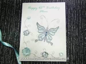 New Birthday card featuring butterfly with flowers