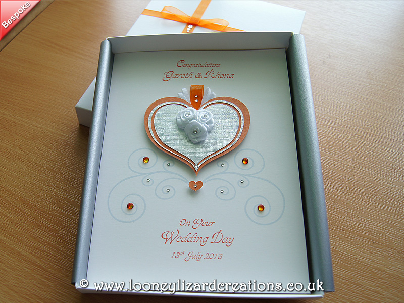 Orange and silver heart with ribbon roses and crystal detail