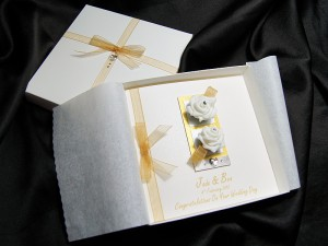 Wedding card with two white roses and gold ribbon
