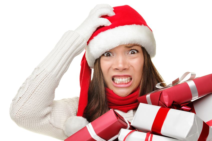Female stressing about christmas, holding christmas gifts