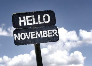 Sign with blue sky and clouds with hello november