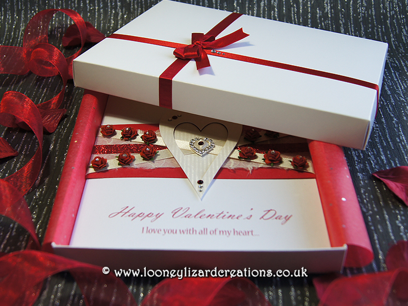 luxury boxed valentines card featuring twelve red roses.