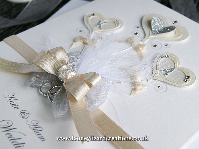 ivory and silver luxury wedding card with three heart shaped balloons
