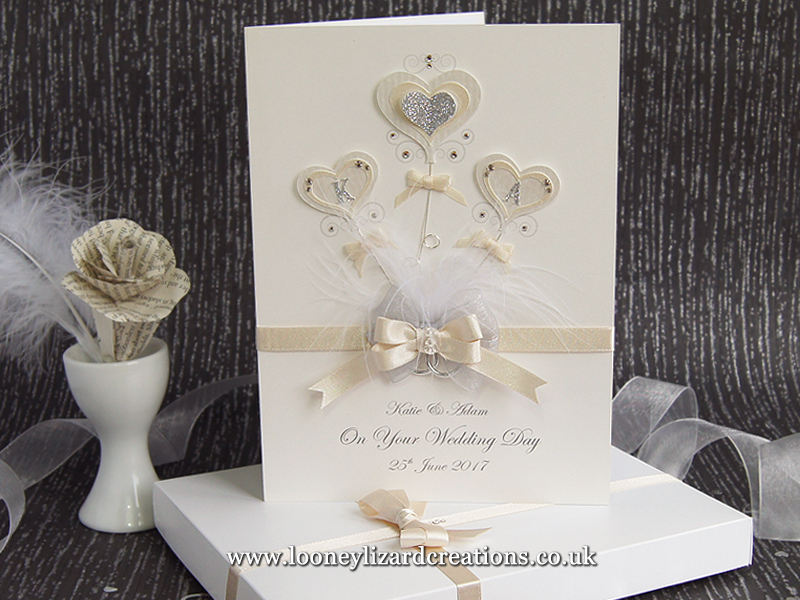 romantic wedding card with heart shaped balloons featuring the couples initials and embellished with crystals and glitter