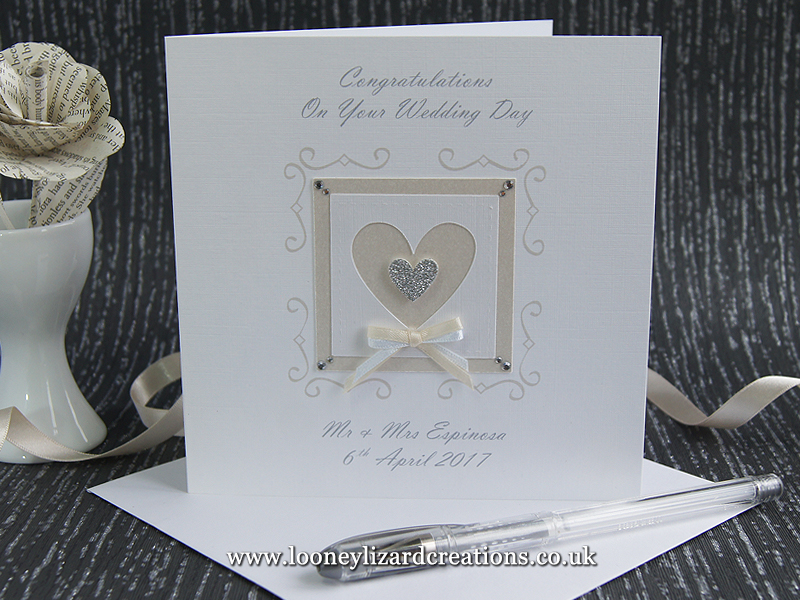 White linen wedding card with a framed heart with silver glitter