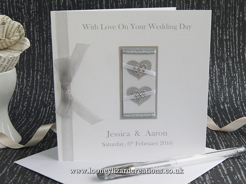 Wedding card featuring two hearts in silver and white