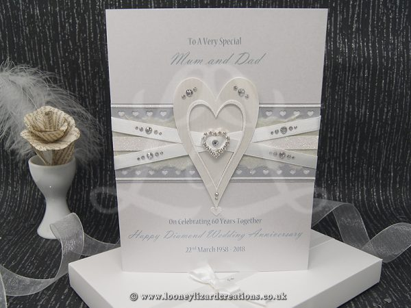 luxury card featuring an ivory heart embellished with white glitter and clear crystals.