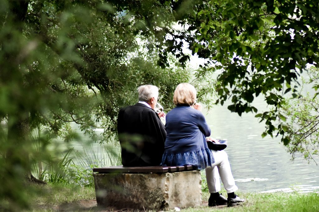 Mature couple sitting together and joying the view