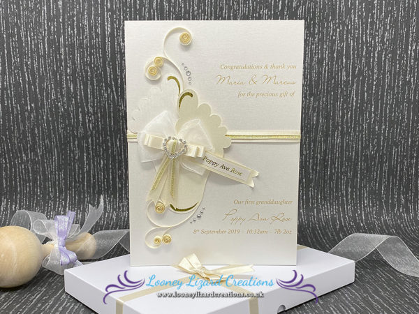Luxury boxed new baby card featuring baby feet, gold foil, mixed ribbons and diamante heart