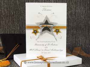 Graduation card featuring pearl and glitter stars, wire, ribbon and crystals with rolled diploma