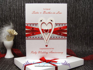 featuring entwined heart with crystals, ribbon and glitter