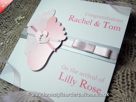Cherished: Features a cute little pair of baby feet and ten little toes! Available in Pink or Blue