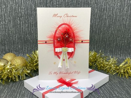 Christmas Rose - A trio of red and white roses with gold wire spirals and swirls