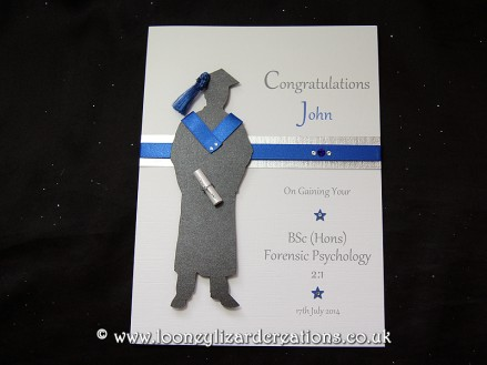 The Graduate: Features a silhouette of a male in graduation cap and gown with matching blue tassel and hood, with degree scroll. Can be fully personalised.