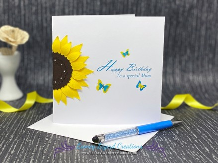 Solar - Featuring a sunflower and a trio of butterflies. A summery design in yellow and turquoise.