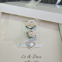 Card featuring white roses and ribbon with heart