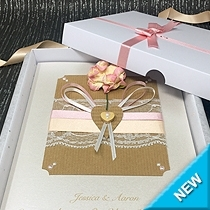 Card featuring a gardenia, lace, ribbon and wooden heart.