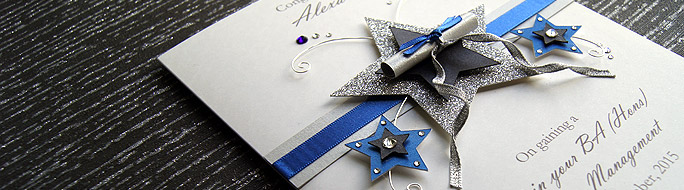 New luxury boxed graduation card, featuring graduation scroll and decorative stars.