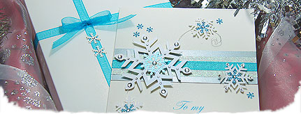 White Christmas luxury handmade card featuring a series of stylised snowflakes
